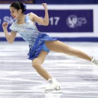Mai Mihara competes in Saturday's free skate at the Cup of China. Mihara placed fourth overall in her first Grand Prix event of the season. | AP