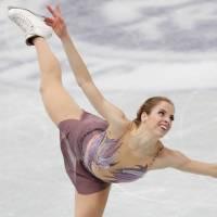 Italy's Carolina Kostner competes in the women's free skate on Saturday at the NHK Trophy. Kostner earned the runner-up spot with 212.24 points. | REUTERS