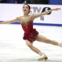 Marin Honda performs her free skate routine at the Cup of China on Saturday in Beijing. Honda finished fifth in the two-day women's competition. | AP
