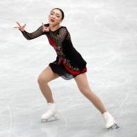 Rika Hongo, who finished in seventh place, performs her free skate on Saturday. | REUTERS