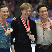 Winner Sergei Voronov of Russia (center), second-place finisher Adam Rippon of the United States (left) and third-place finisher Alexei Bychenko of Israel are seen during the NHK Trophy men's awards ceremony on Saturday night. | AFP-JIJI