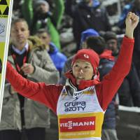 Junshiro Kobayashi celebrates after his first victory at the 2017-18 FIS Ski Jumping World Cup on Sunday in Wisla, Poland. | AP