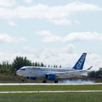 A new bombardier aircraft CSeries lands in Mirabel, Quebec, in 2013. U..S trade officials are expected to confirm massive tariffs on Bombardier planes in a case that has inflamed relations between Washington and Ottawa. The trade dispute stems from a complaint by aerospace giant Boeing against its Canadian rival that found a receptive ear in President Donald Trump, whose 'America First' agenda has vowed a tough line in matters of international commerce. | AFP-JIJI