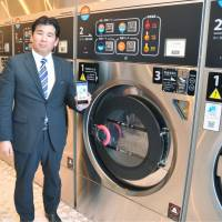 Laundromats tap smartphones to offer payment service and info on open machines
