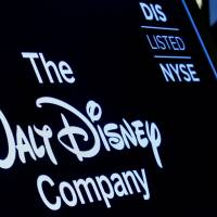 A screen shows the logo and a ticker symbol for The Walt Disney Company on the floor of the New York Stock Exchange (NYSE) in New York Thursday. | REUTERS