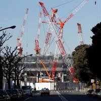 Japan's jobless rate improved to a 24-year low as spending rose in November