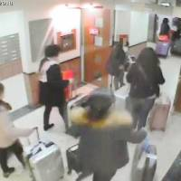Travelers who have used vacation rental websites such as Airbnb are seen in security camera footage at a condominium building in Osaka on Jan. 1. | KYODO