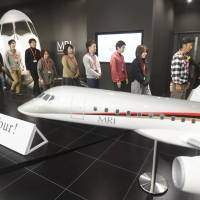 People line up at the MRJ Museum inside Nagoya Airport on its opening day Nov. 30 in Toyoyama, Aichi Prefecture. | KYODO