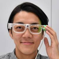 Keisuke Shimakage, CEO of Tokyo-based startup Oton Glass, wears a pair of glasses that can read aloud text in the wearer's field of view. | YOSHIAKI MIURA