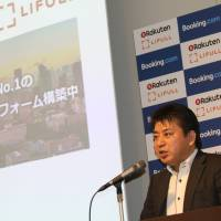 Munekatsu Ota, head of Rakuten Lifull Stay Inc., speaks about his company's partnership with Booking.com, and his plans for the vacation rental business, on Monday in Tokyo. | RAKUTEN INC.