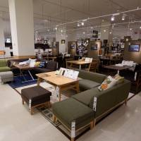 Furniture awaits buyers at a Nitori store in Tokyo. Nitori Holdings Co. last week deployed 79 robots to move around shelves filled with products at its Osaka distribution center. | BLOOMBERG
