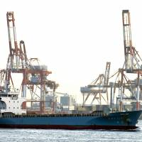 A vessel passes through the busy port of Yokohama. | BLOOMBERG NEWS
