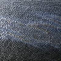An oil sheen drifts from the site of the former Taylor Energy oil rig in the Gulf of Mexico, off the coast of Louisiana, in 2015. Federal officials say they have found fresh evidence of an 'ongoing oil release' at the site of a 13-year-old oil leak in the Gulf of Mexico, where chronic sheens often stretch for miles off Louisiana's coast. | AP