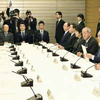 Prime Minister Shinzo Abe is seen attending a meeting with other ministers to discuss trade issues, at the prime minister's office in Tokyo on Nov. 24. | KYODO