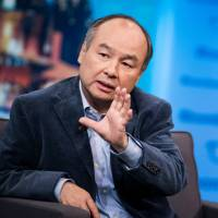 SoftBank Group Chairman Masayoshi Son is interviewed on 'The David Rubenstein Show' in New York in September. | BLOOMBERG