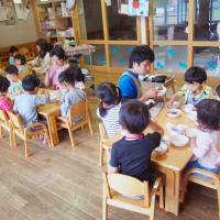Some parents say that the government's free day care plan is wasteful because even households that make a lot of money, and can afford expensive private day care, will be reimbursed if the program is implemented. | KYODO