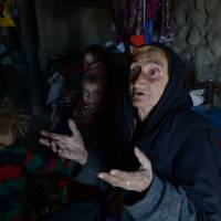 Janat Bibi talks with a reporter during an interview in the village of Shemol in October. | AFP-JIJI