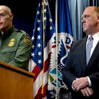 U.S. Customs and Border Protection Acting Deputy Commissioner Ronald Vitiello, laccompanied by Acting Director for U.S. Immigration and Customs Enforcement Thomas Homan, speaks at a Department of Homeland Security news conference at the Ronald Reagan Building in Washington Tuesday to announce end-of-year numbers regarding immigration enforcement. | AP