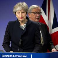 European Commission President Jean-Claude Juncker walks behind British Prime Minister Theresa May prior to addressing a news conference at EU headquarters in Brussels on Monday. | AP