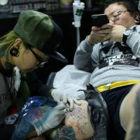 Covered in ink: Chinese women peel away tattoo's social stigma
