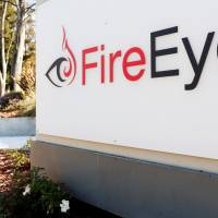 The FireEye logo is seen outside the company's offices in Milpitas, California, in 2014. | REUTERS