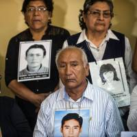 Relatives of victims of Peruvian President Alberto Fujimori's regime and their lawyers attend a news conference in Lima on Wednesday. | AFP-JIJI