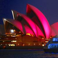The Sydney Opera House is illuminated in pink on Friday to mark the passage of the marriage equality bill. | REUTERS