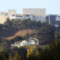 The Getty Center is seen after a wildfire swept through Los Angeles' Bel Air neighborhood on Wednesday. The $1 billion home to the J. Paul Getty Museum and related organizations, stands on the west side of Sepulveda Pass. The fire did not immediately cross the wide expanse of the pass to the Getty side, but if it had, the facility is prepared. | AP