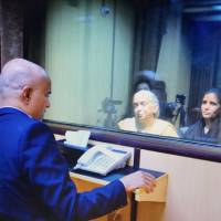 In this handout photo released by Pakistan Foreign Minister, the wife and mother of imprisoned Indian naval officer Kulbhushan Jadhav meet with Jadhav at Foreign Ministry in Islamabad Monday. | PAKISTAN FOREIGN MINISTRY / VIA AP