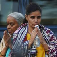 The wife and mother of Kulbushan Sudhir Jadhav,an Indian national sentenced to death for spying in Pakistan, leave after meeting with Jadhav at the Foreign Ministry in Islamabad on Monday. Pakistani authorities allowed an Indian national sentenced to death for spying to see his family for the first time since his arrest, a rare and highly-anticipated meeting arranged amid tight security in Islamabad. | AFP-JIJI