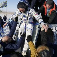 Space capsule brings astronaut trio back to Earth after 139-day stay aboard ISS