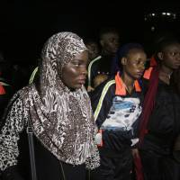 Nigerian returnees from Libya wait to be registered upon arrival at the Murtala Muhammed International Airport in Lagos Tuesday. Hundreds of Nigerians have returned from Libya as part of an organized repatriation by The African Union and member states amid outrage over recent footage that showed migrants being auctioned off as slaves. | AP