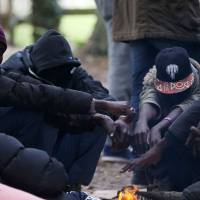 Migrants seek refuge in small Normandy port, aided by locals