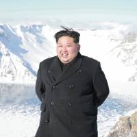 North Korean leader Kim Jong Un visits Mount Paektu in this photo released Saturday. | REUTERS