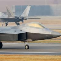 U.S. Air Force F-22 stealth fighter jets are seen at an air base in Gwangju, South Korea, on Monday after the two allies kicked off their largest-ever joint aerial exercise. | AFP-JIJI