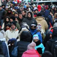 People bundle up against the cold as they walk in Times Square in Manhattan, New York, Thursday.   REUTERS