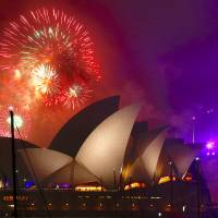 Sydney's fireworks extravaganza kicks off global New Year party agenda
