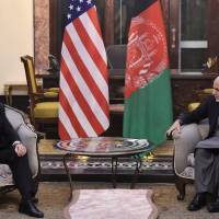 U.S. Vice President Mike Pence meets with Afghan President Ashraf Ghani (right) at the Presidential Palace in Kabul Thursday. | REUTERS