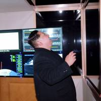 North Korean leader Kim Jong Un watches Wednesday's missile launch on a screen. | AFP-JIJI