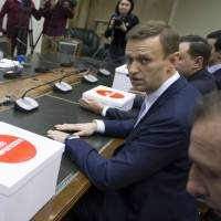Russian opposition leader Alexei Navalny calls for boycott of presidential vote after he is barred from running against Putin