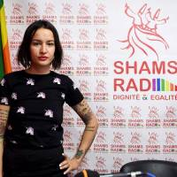 Tunisian activist Amina Sboui, also know as Amina Tyler, a radio presenter on the new 'Shams Radio,' the first LGBT radio in the Arab region, poses for a photo in the studio during the opening of the radio station on Monday in Tunis. | AFP-JIJI