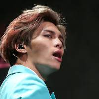Kim Jong-hyun, the lead singer for South Korea's top boy band SHINee, performs in this undated photo. | REUTERS