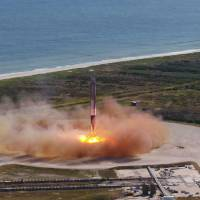 In SpaceX first, recycled rocket soars with recycled capsule
