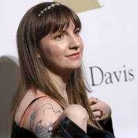 Lena Dunham attends the Clive Davis and The Recording Academy Pre-Grammy Gala in Beverly Hills, California, in February. In a new New York Times report, Dunham claims that she warned Hillary Clinton's communications director about Harvey Weinstein's behavior. She told the Times that when she worked with the Clinton presidential campaign last year, she tried to warn that Weinstein was 'a rapist, and this is going to come out at some point.' | RICH FURY / INVISION / VIA AP