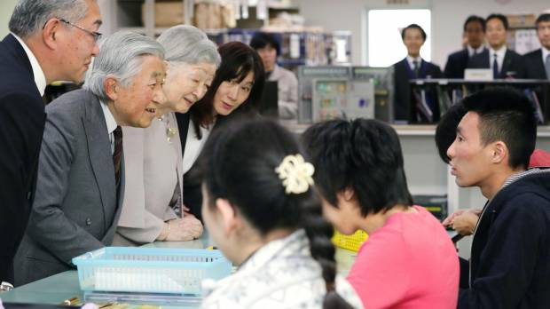 Emperor Akihito and Empress Michiko visit disabled workers at a Tokyo department store on Friday, the day the Cabinet formally approved the Emperor's abdication date of April 30, 2019.
