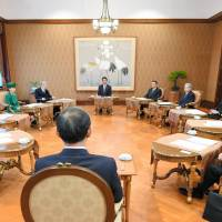 Ten members of the Imperial House Council, including Prime Minister Shinzo Abe, gathered Friday to discuss the date for Emperor Akihito's planned abdication. | POOL / VIA KYODO