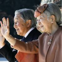 Emperor Akihito and Empress Michiko wave to Luxembourg's Grand Duke Henri after their meeting at the Imperial Palace in Tokyo on Monday. News that the Emperor wished to abdicate stunned the nation when it was first reported last year.  | AP
