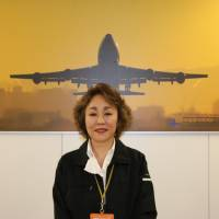 Airhearse International Inc. President Rie Kimura, who heads a six-person operation that handles the international repatriation of human remains, poses for a photo Oct. 23 in Tokyo. | KYODO