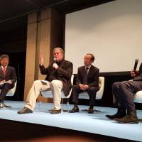 Former White House chief strategist Steve Bannon participate in a panel discussion in Tokyo on Sunday. | TOMOHIRO OSAKI