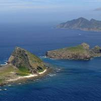 Senkaku islets Minamikojima (front), Kitakojima and Uotsuri (back) are shown in the East China Sea in June 2011. China and Taiwan also claim sovereignty over the Japan-administered chain. KYODO